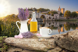 Lavender still life with cup of coffee against Avignon bridge in Provence, France - 222110205