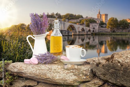 Leinwanddruck Bild Lavender still life with cup of coffee against Avignon bridge in Provence, France