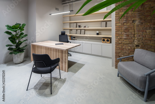 Foto Murales Stylish office in loft style with gray walls