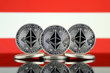 Physical version of Ethereum (ETH) and Austria Flag. Conceptual image for investors in cryptocurrency, Blockchain Technology, Smart Contracts, Personal Tokens and Initial Coin Offering. - 222116414