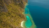 Aerial seascape tropical lagoon with azure water and coral reef among rocks with tropical vegetation, Palawan, Philippines Travel concept, Aerial footage. - 222123659