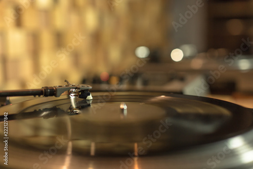 Playing vinyl in the studio on blurred background - 222127842