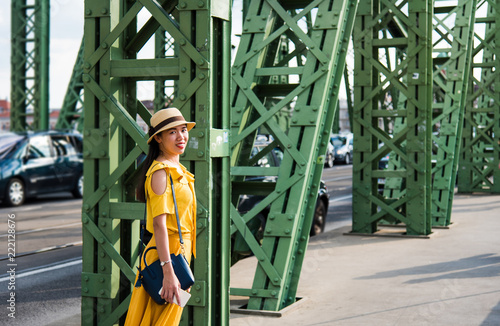 Fototapeta Portrait of a girl standing on the bridge