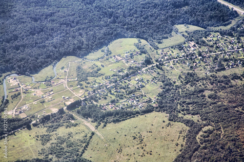 Foto Murales airview landscape with buildings and forest