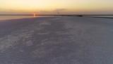 Coast of the estuary at sunset where tourists and kitesurfers rest - 222136290
