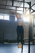 Sportswoman Training In Crossfit Workout Gym