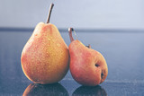 Two yellow big ripe pears . Autumn background.
