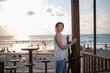 A woman in a seaside cafe