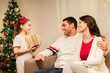 holidays, family and celebration concept - happy mother, father and little daughter with christmas present at home