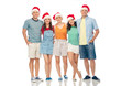 christmas, holidays and friendship concept - group of happy smiling friends in santa hats over white background