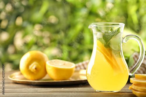 Leinwandbild Motiv Jug of fresh lemonade on wooden table