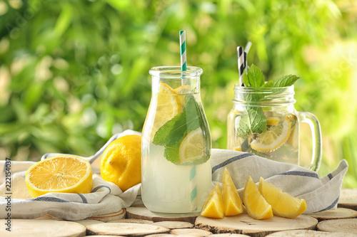 Leinwandbild Motiv Glassware of fresh lemonade on wooden table