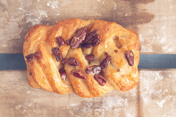 braid cake with nuts on wooden background