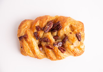 braid cake with nuts on white background