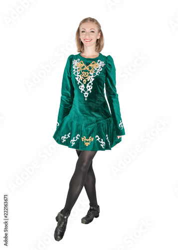 Beautiful young woman in Irish dance green dress isolated