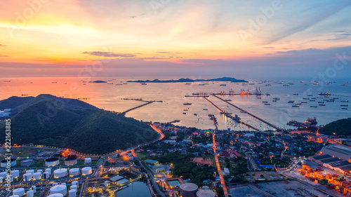Leinwanddruck Bild Industrial view at oil refinery plant form industry zone with sunrise and cloudy sky.Oil refinery and Petrochemical plant at dusk,Thailand. Aerial view