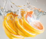 Orange falling to the water. Suitable for advertisement. - 222177875