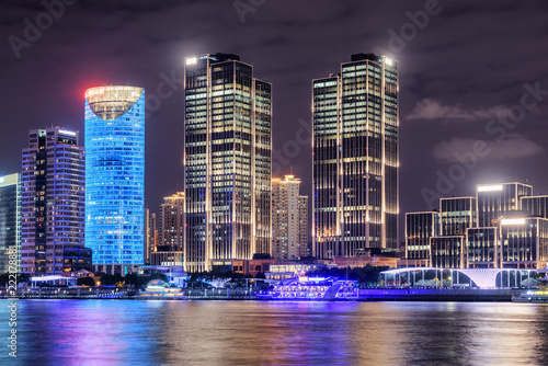 Night view of modern waterfront buildings. Shanghai, China