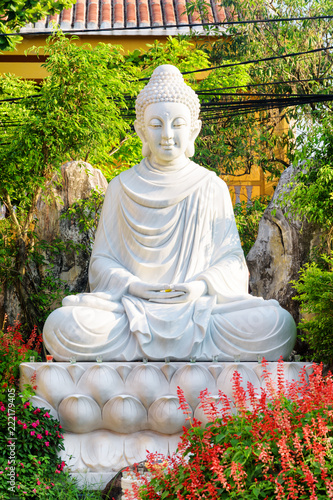 Buddha statue in scenic garden at Hoi An Ancient Town