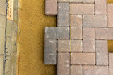Block paving and sharp sand with a string line - 222180455