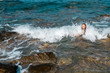 happy  young lady swims at the sea