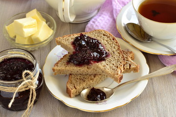 Wholegrain toast with blackcurrant jam and butter