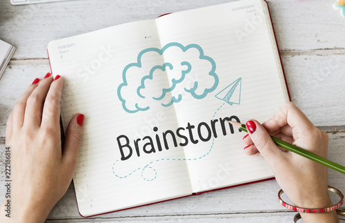 Woman writing Brainstorm on a notebook - 222186814