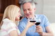 Mature couple toasting wine glasses - 222189631