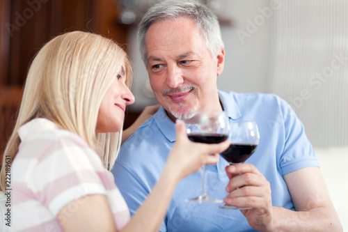 Mature couple toasting wine glasses