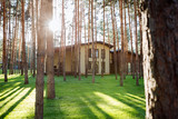 Beautiful building. Close up of a beautiful nice house standing in the woods - 222192289
