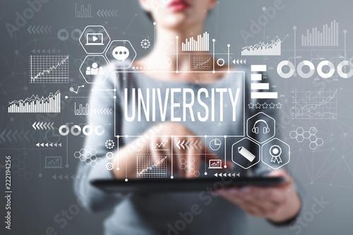 Leinwanddruck Bild University with business woman using a tablet computer