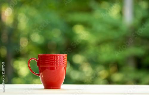 Sticker A coffee mug on a shiny green forest background