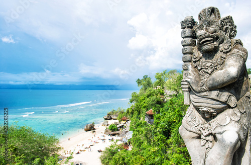 Stone balinese statue Blue sea sky tropical sand beach - 222203225