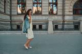 Portrait of stylish smiling, happy brunette woman walking on the - 222204413