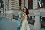Portrait of stylish smiling, happy brunette woman walking on the - 222204448