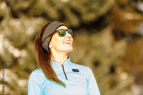Winter workout. Girl wearing sportswear and sunglasses. - 222206675