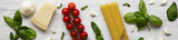 Ingredients for cooking italian pasta on a white wooden background. Flat lay. Top view.