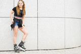 Young woman riding roller skates - 222210022