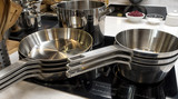 Kitchen utensils and tableware on shelf. Group of stainless steel kitchenware. - 222210253