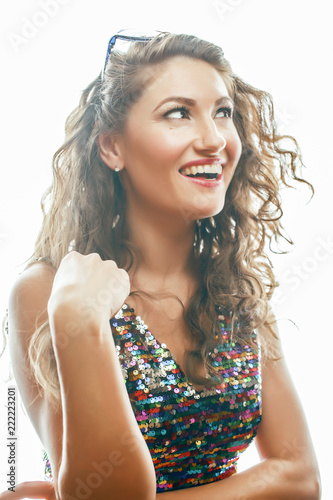 young pretty woman with curly hair style posing emotional on whi