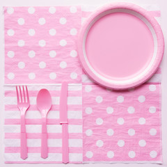 Pink color paper plate with plastic spoon, fork and knife for children party design