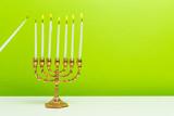 Bronze Hanukkah menorah with burning candles - 222252496