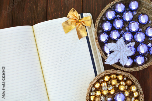 Christmas background with a paper for your signature and festive decor. Pre-holiday preparation concept with a list to do.