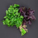 Collection of herbs and spices on a black background - 222276877