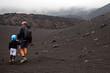 Padre e figlio in escursione sul vulcano Etna, Sicilia, Italy - 222286064