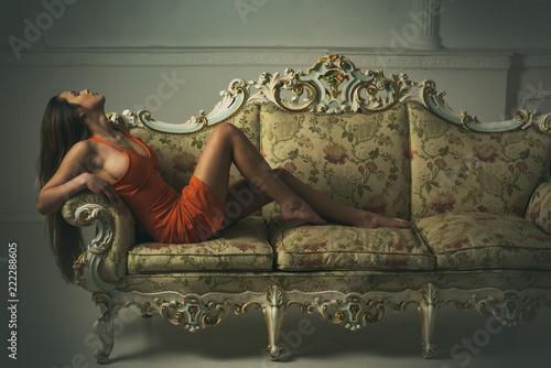 Fashion woman with fashionable look relax on sofa. Fashion never sleeps