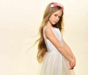 beauty salon. beauty salon services. long hair for little girl in beauty salon, copy space. small girl kid in beauty salon isolated on white. gorgeous and pretty.