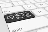Computer-Tastatur mit einer schwarzen Taste und der Aufschrift Service Rundum Die Uhr