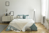 A big comfortable bed with pale sage green and white linen, pillows and blanket in a woman's bright bedroom interior with windows. Real photo. - 222300222