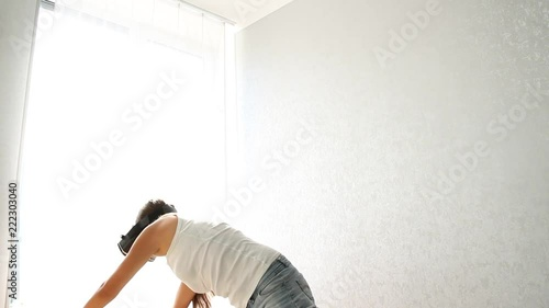 Poster Young woman using virtual reality headset, VR, yoga